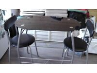 Small table and two chairs for sale