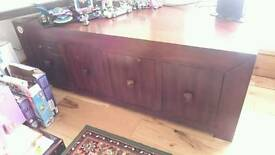 4 deep drawers solid wood piece of furniture.