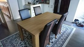 Table and four faux leather chairs