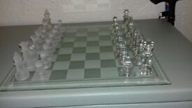 traditional chess set with glass board