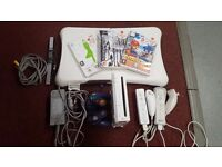 Nintendo Wii with 3 games, 2 Wii controllers, 1 Gamecube controller and Wii Fit board