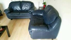 Two dark blue leather 2 seater sofas