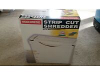 Paper shredder suitable for home office. Shreds 4 A4 sheets at once.