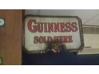Antique guinness sign pub bar