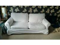White 2 seater sofa bed. Seats 3 sleeps 2. Good condition. Pick up West End.