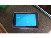 Nexus 7 in excellent condition. fully reset. Comes with pink cover
