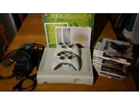Xbox 360 with 20Gb hard drive, controller, cables, and 12 games