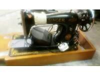 singer sewing machine ..