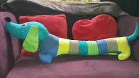 Colourful Dog draft excluder