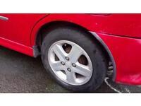 Red 5 Seater Daihatsu