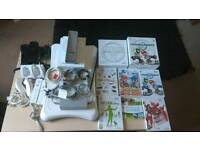 Nintendo Wii with games and fitness