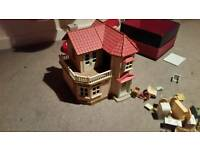 Sylvanian families dolls house and loads of furniture