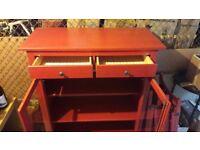 Red Ikea storage cupboard