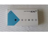 Boxed and never used Blue Nintendo DSi with EU and US Adaptors (no UK)