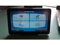 "7""satellite navigation tablet, with dash fitting kit, also plays media videos photos etc."