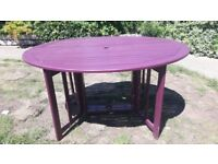 Garden table - oval shaped - drop-leaf sides - solid teak/painted purple