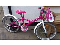 kids bike Btwin girls for 6-8 years old. Pink obviously. Quick release seat post. Bell & front bag.