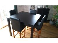 High dining room table and 4 bar chairs