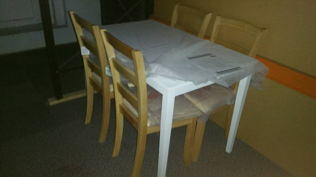 A brand new 2 tone 4 seated dining set