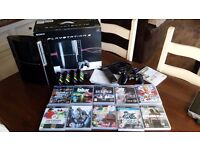 PLAYSTATION 3 BUNDLE WITH 1 x CONTROL, 4 x BUZZ CONTROLS, REMOTE CONTROL AND 11 GAMES