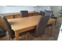 Oak Furniture Package. Oak Dining table with 4 brown leather chairs with matching items.