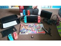Nintendo switch with games and accesories