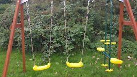 Plum® Colobus Wooden Swing Set + Glider