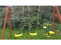 Plum® Colobus Wooden Swing Set + Glider