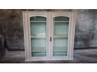 Glass freshly painted cabinet