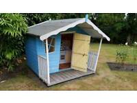 Children's wooden crooked playhouse