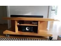 Wood Entertainment unit on wheels. For TV, audio equipment, etc...