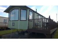 Swift Moselle 6 berth luxury caravan sited at Ocean Heights, New Quay, WALES