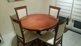 Solid wood extendable dinning table and chairs.