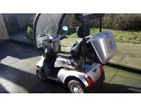 Breeze 4 wheel scooter with canopy has cosmetic damage on front drives perfect cost 5000 new