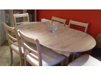 Limed oak Dining room table and chairs and glass cabinet