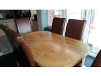 G Plan light oak dining table and 6 high back leather chairs
