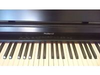Electric digital piano - Roland HP135 with Stool.