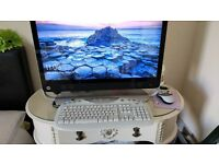 "HP All in one computer 27"" screen. Windows 10 4gb memory. i3 processor. 1TB hdd"