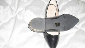 Carvella by Kurt Geiger flat black patent shoes. New