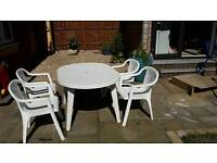 White 4-seat patio set (chairs and table)