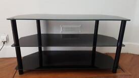 Black glass 3 shelf TV stand.