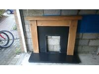 rustic oak fire surround and slate hearth and insert
