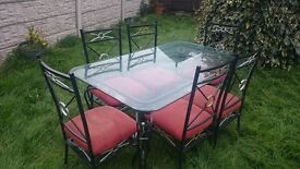 Raw iron & Glass table with 6 sturdy chairs