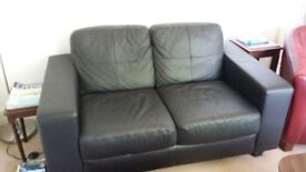 Black leather sofa (2 person) + 2 Red armchairs