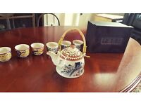 Totally unique traditional Chinese tea set. Brand new and still boxed. Includes 6 tea cups