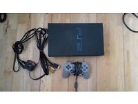 PS2 Console with controller and games