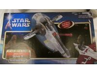 Collection of Star Wars figurures and vehicles.