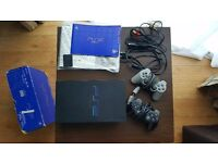 Sony Playstation 2 console and 2 controllers