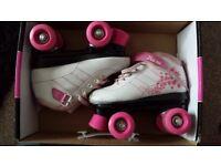 Girls SFR quad skates. very nice. £10 ono