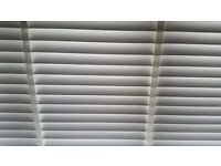 White wood slatted blind with tapes